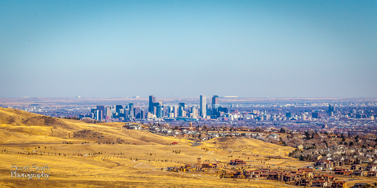 A Hill with a View - From Morrison, CO - a view of downtown Denver, and even the white canopies of the airport terminals in the distance. by D Scott Smith