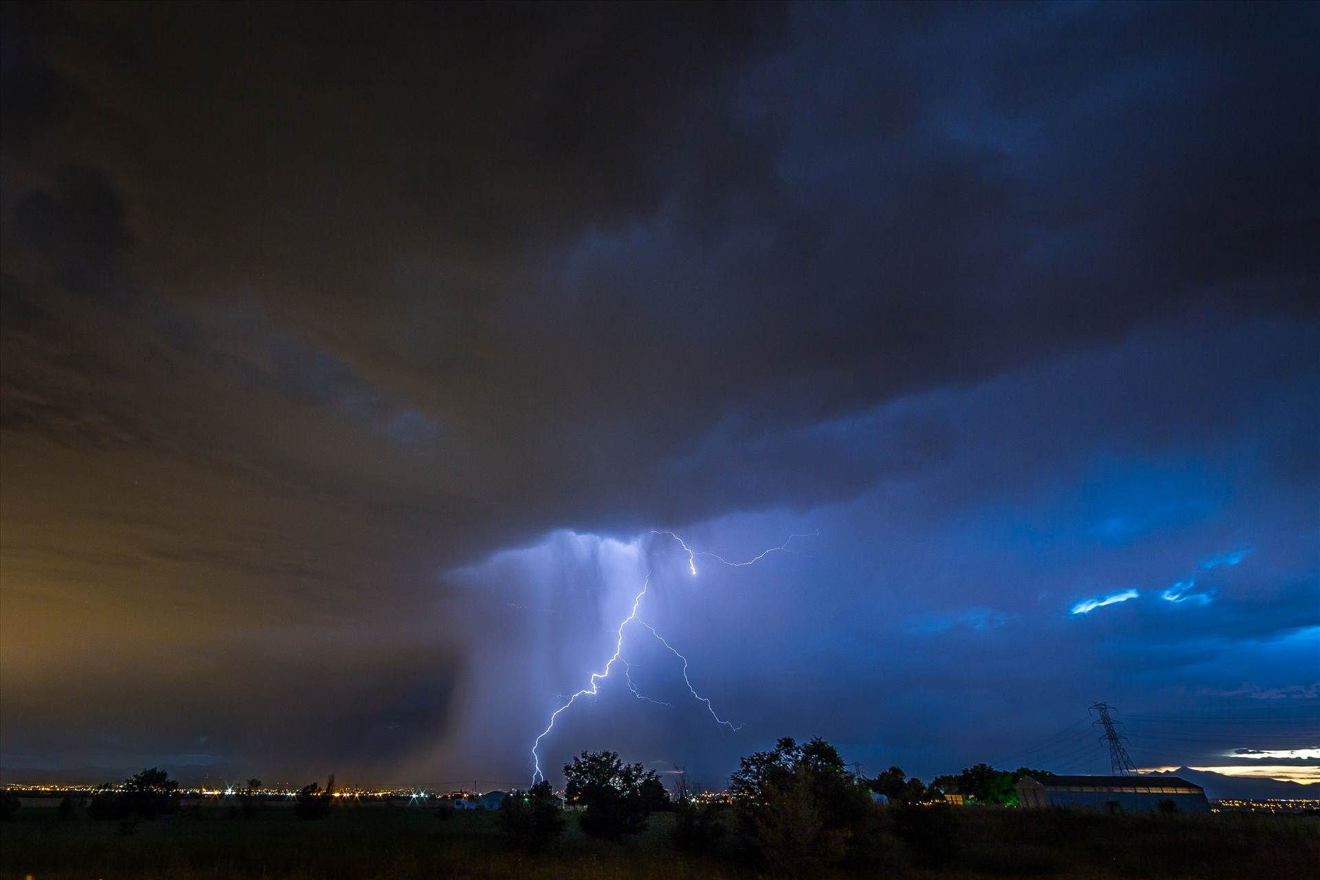 Lightning Flashes 8 - A series of shots from the end of the street, during a powerful lightning storm near Reunion, Colorado. by D Scott Smith