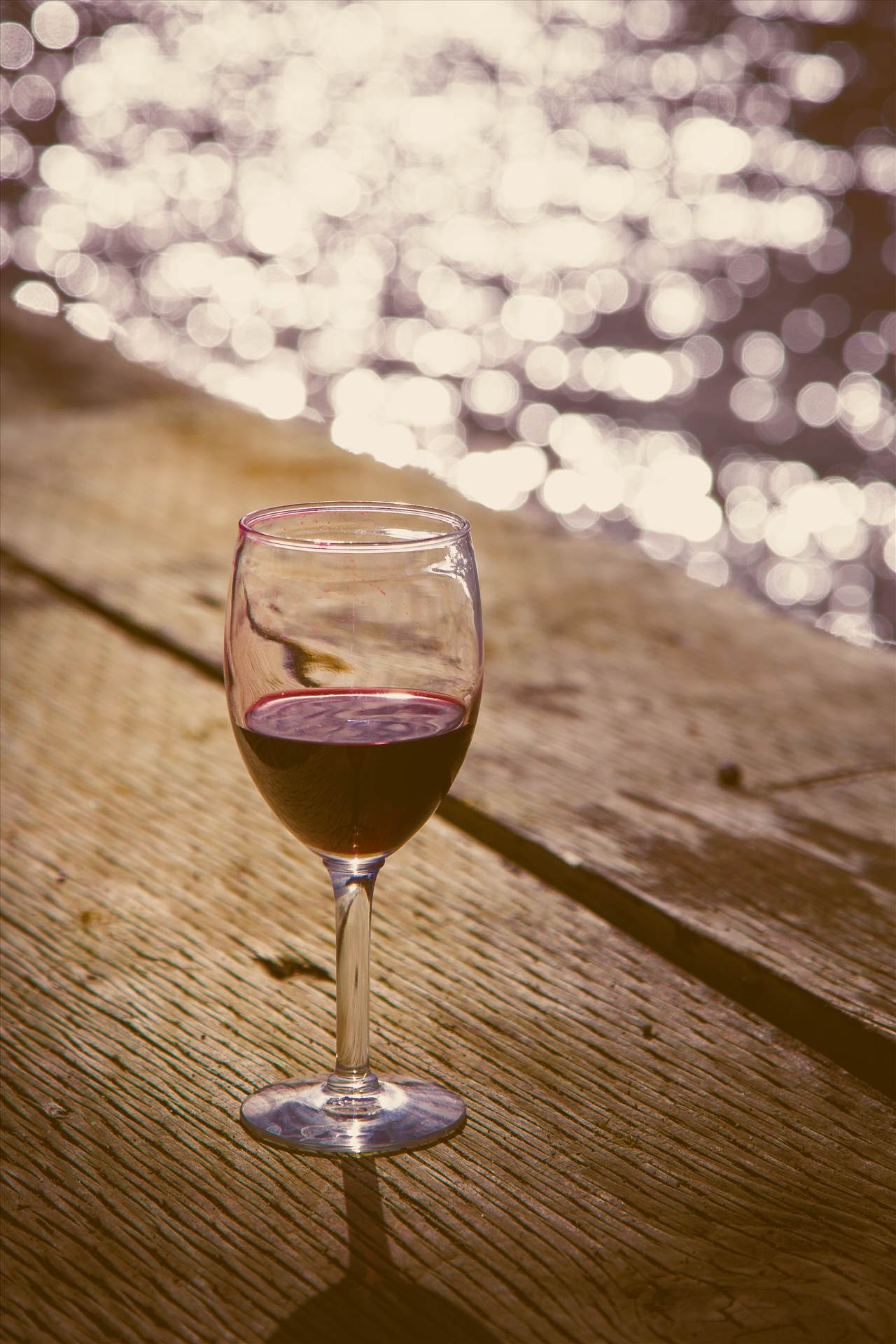 Sunset on the Bay - A glass of wine as the sun sets on Puget Sound, Seattle by D Scott Smith