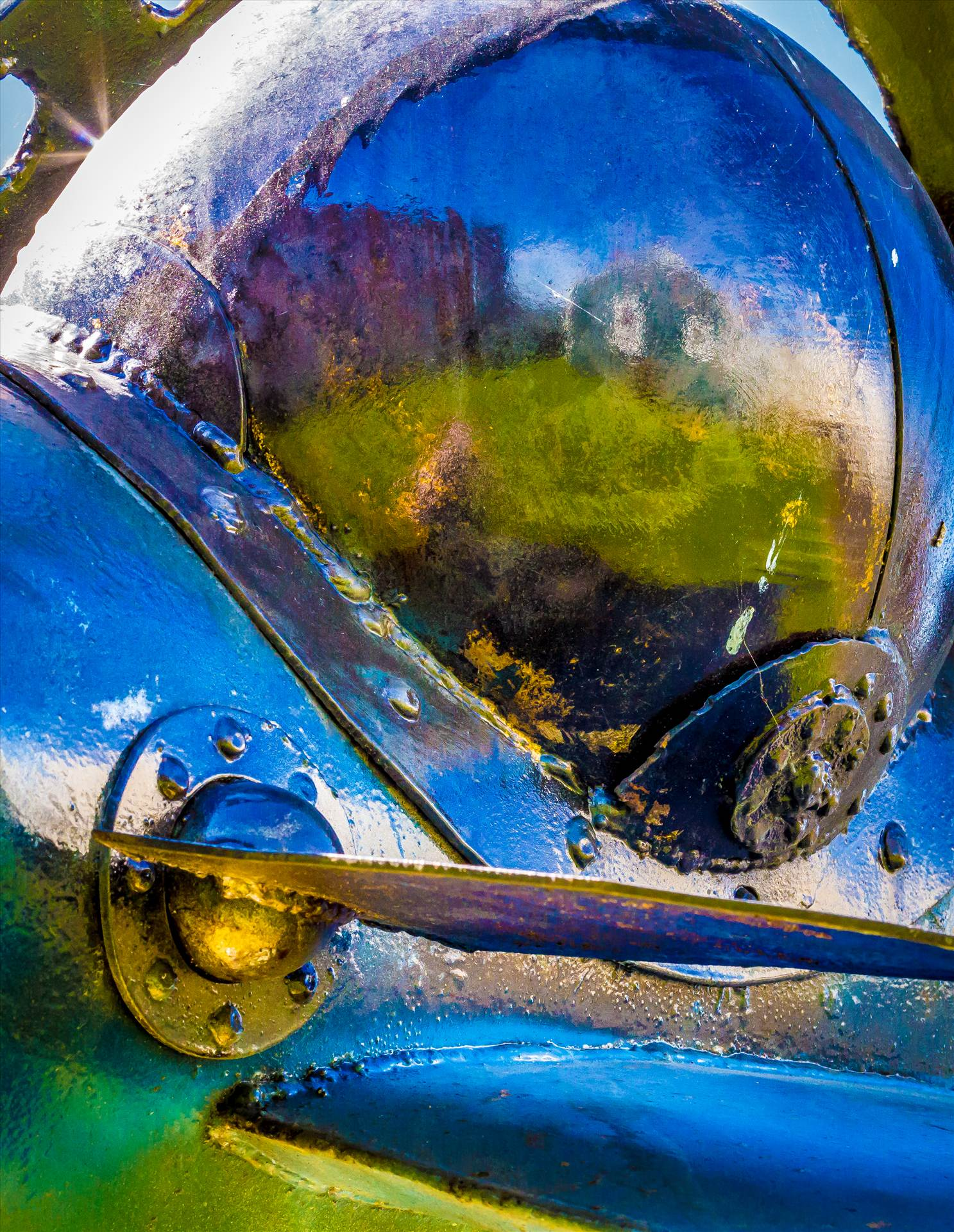 Shimmer - Close-up of an abstract sculputure in Langley, Washington. 'Star Chaser 2' by John Moritz. by D Scott Smith