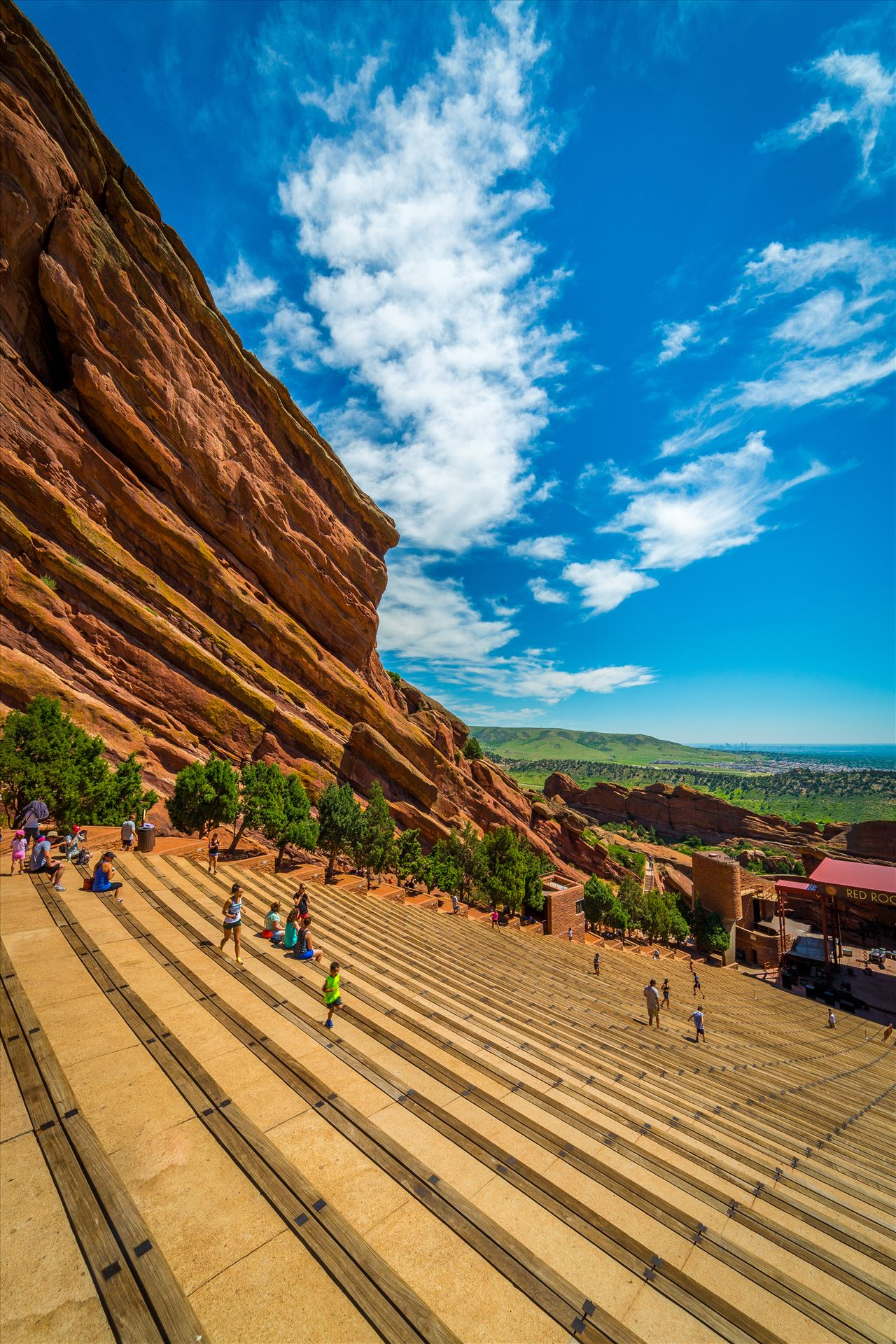 Red Rocks Amphitheater - People getting a workout at Red Rocks amphitheater on a warm Sunday morning. by D Scott Smith
