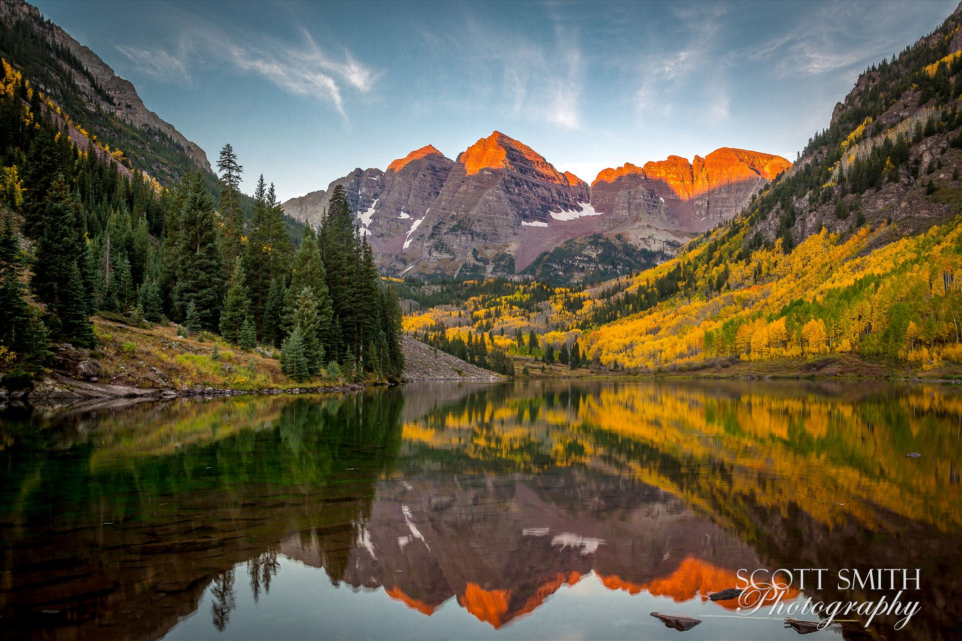 The sun rising on the Maroon BellsA chilly September morning.  The sun lights the peaks of the Maroon Bells.