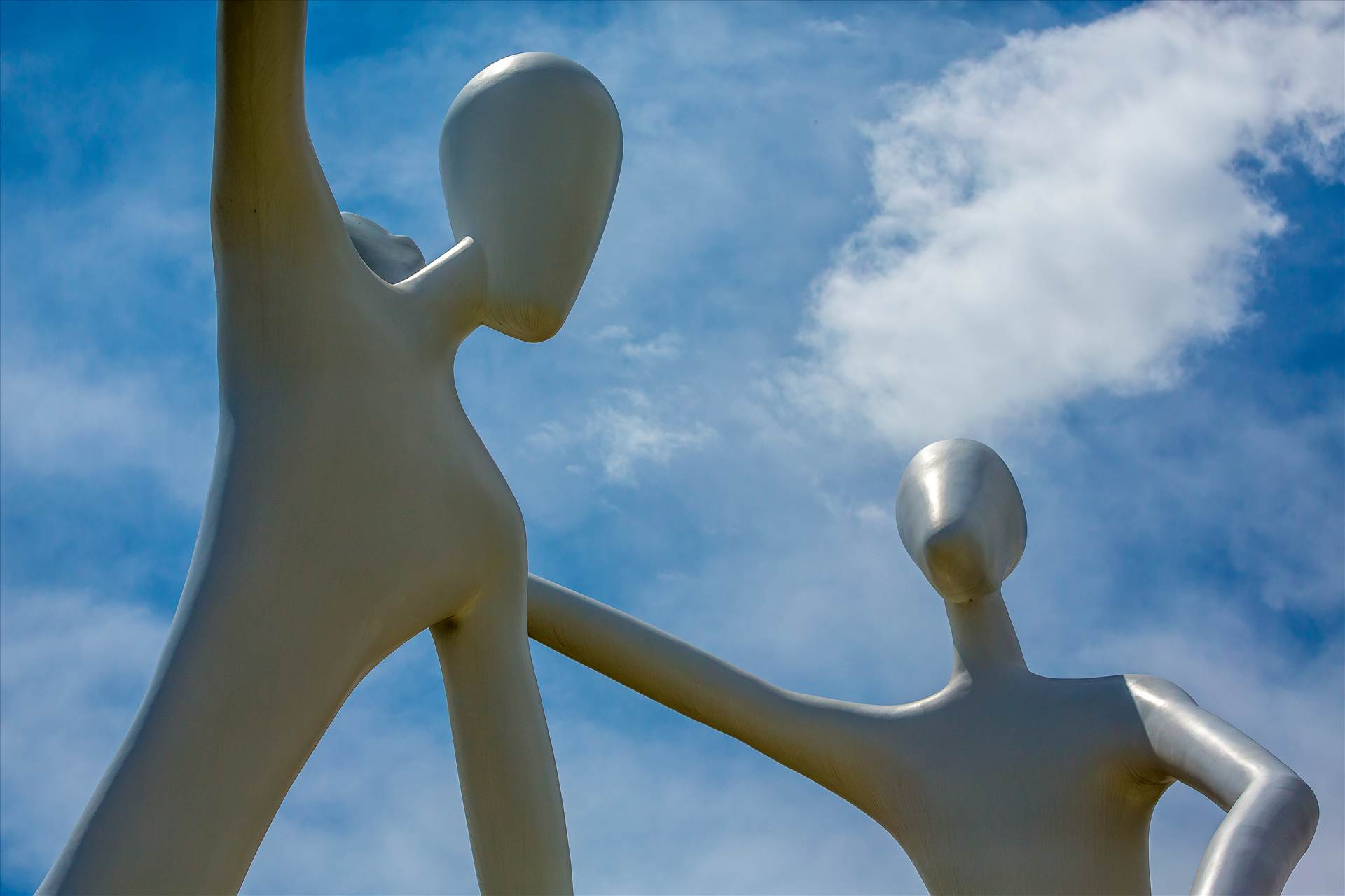 Dancing at the Denver Performing Arts Complex - The famous larger-than-life dancing statues at the Denver Performing Arts Complex. by D Scott Smith