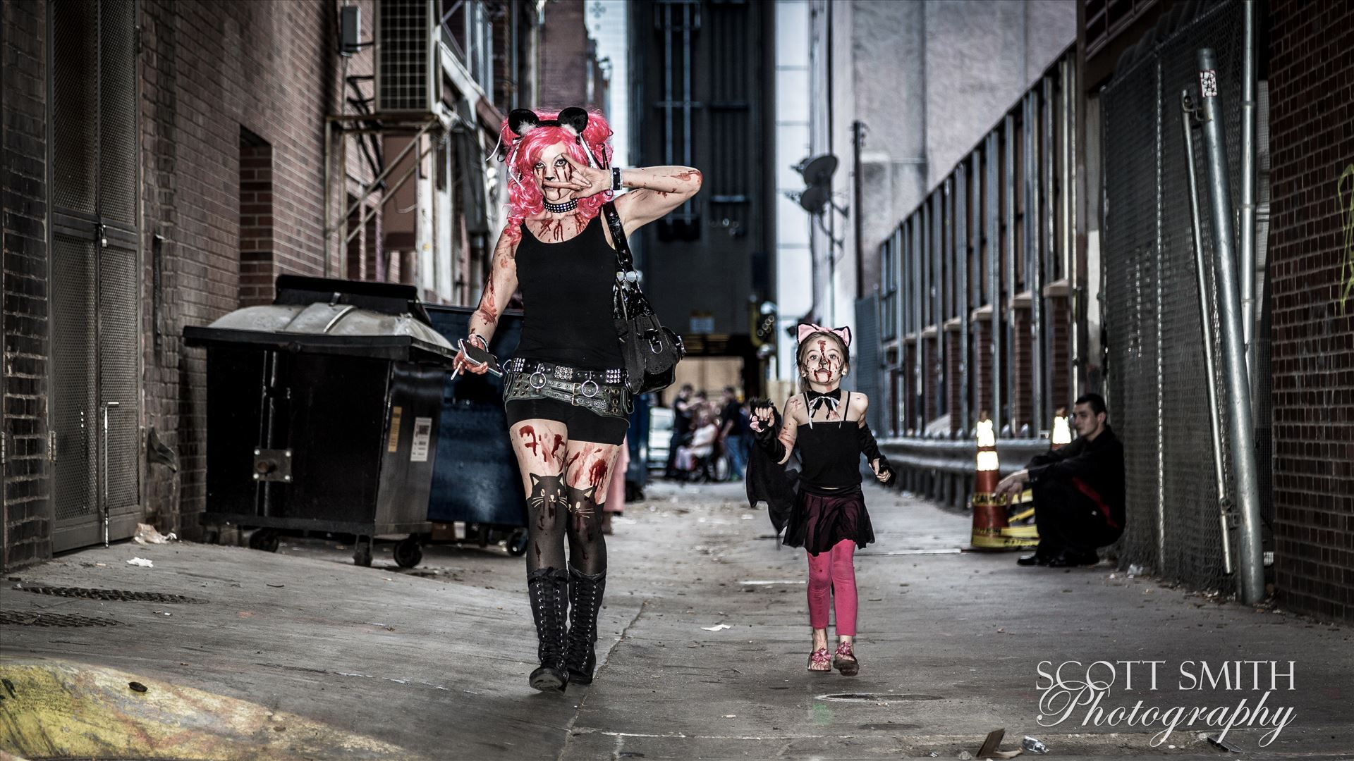 Denver Zombie Crawl 2015 18An adorable mother and daughter walking through an alley during Denver's 2015 Zombie Crawl.