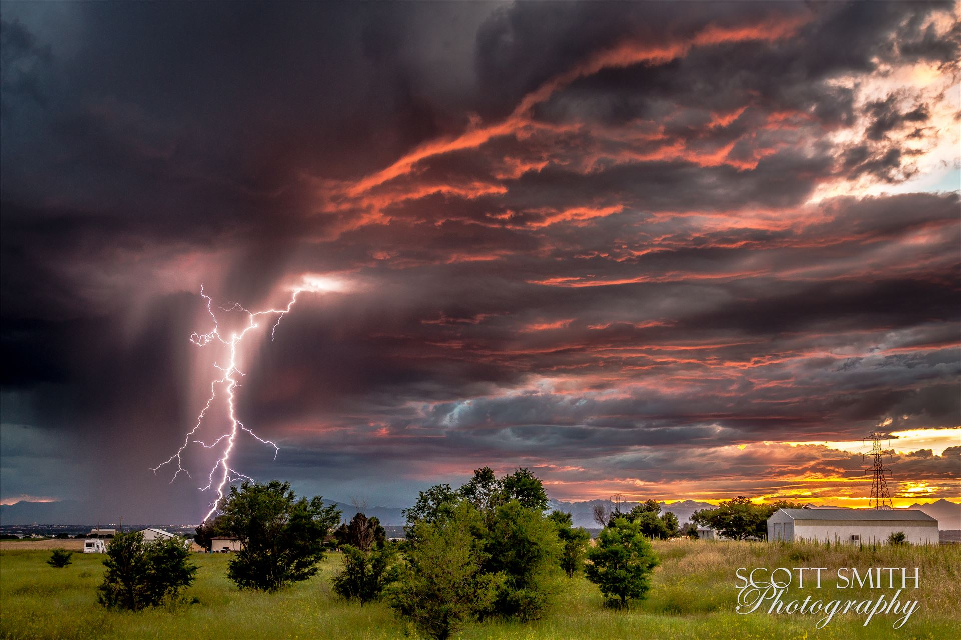 Colorado Sunset and Lightning - Sunset and the beginning of a major lightning storm, east of Denver, Colorado. by D Scott Smith
