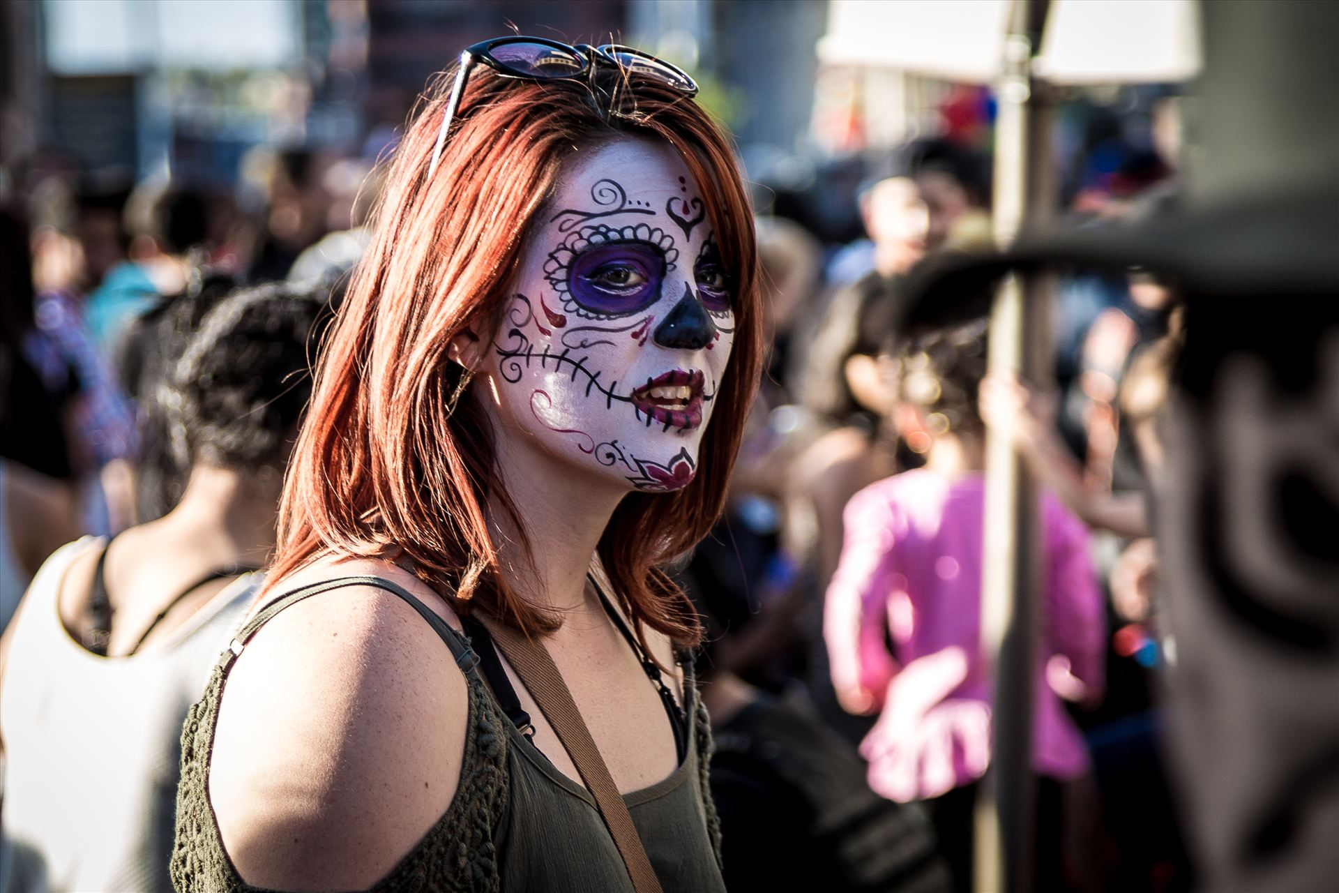 Denver Zombie Crawl 2015 21 - A redhead with day of the dead makeup at the Denver Zombie Crawl 2015 by D Scott Smith