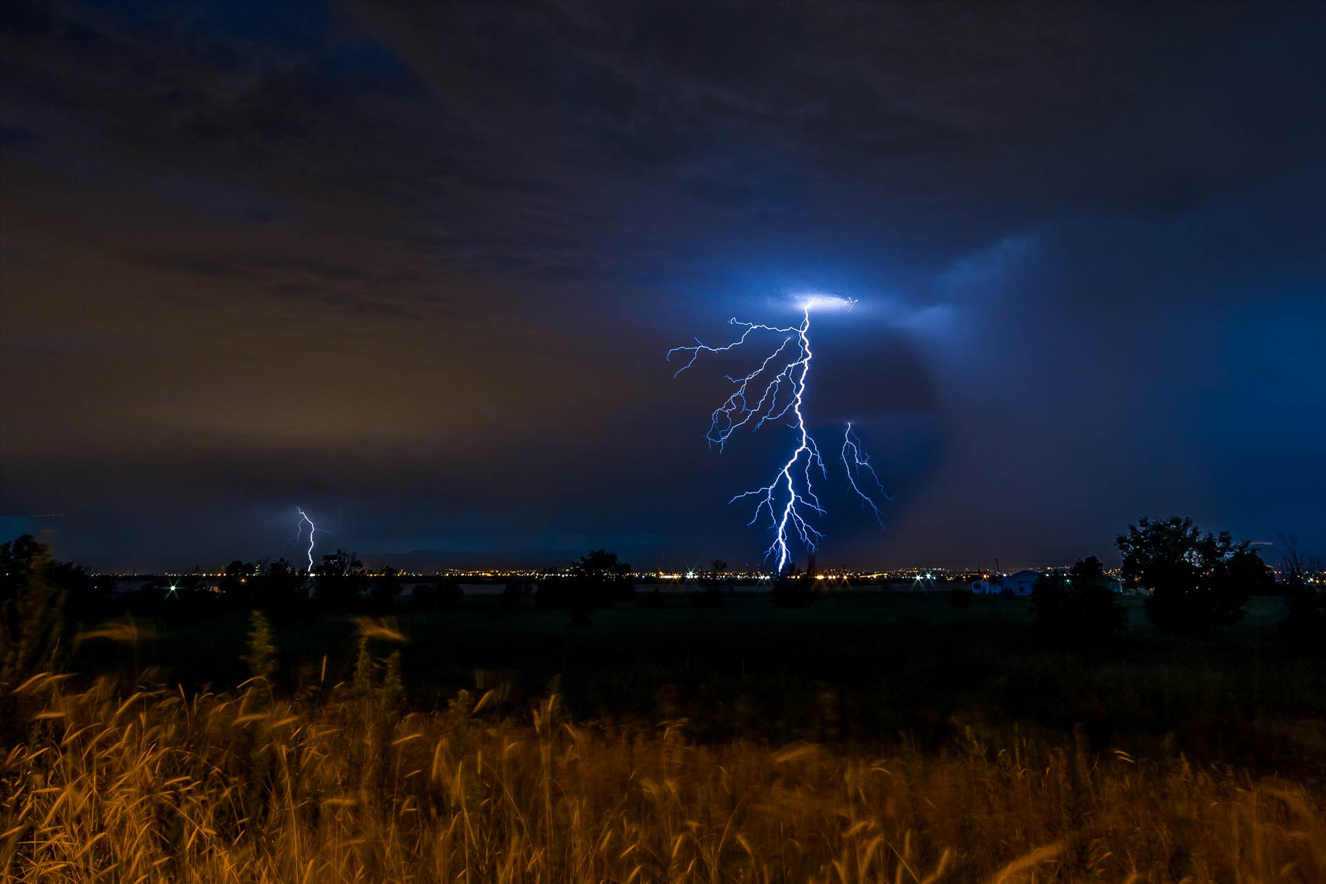Lightning Flashes 6 - A series of shots from the end of the street, during a powerful lightning storm near Reunion, Colorado. by D Scott Smith