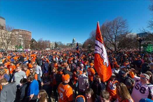 Broncos fans at Civic Park - Fans of the Denver Broncos completely fill Civic Park in Denver Colorado. The state capitol building is visible in the center of the frame.
