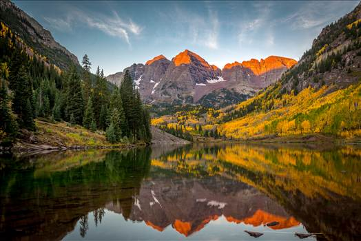 The sun rising on the Maroon Bells - A chilly September morning.  The sun lights the peaks of the Maroon Bells.