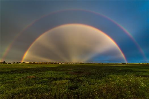 Double Rainbow with Anti-Crepuscular Rays - After a hard rain and a bit of hail, anti-crepuscular rays appear to cast from the center of a double rainbow, near Reunion, Colorado.