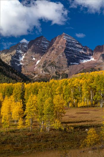 The Maroon Bells a few miles from the lake framed by beautiful fall aspens.