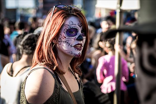 A redhead with day of the dead makeup at the Denver Zombie Crawl 2015