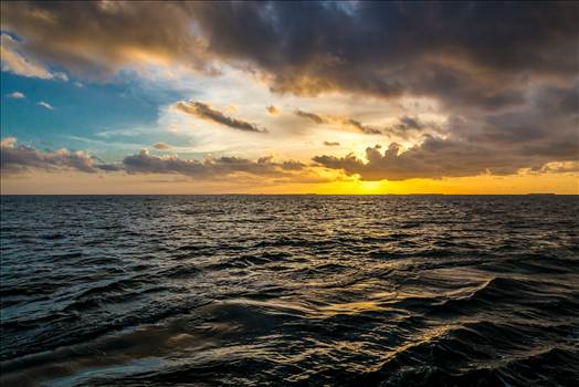 Sunset Cruise - The sun sets outside of Key West, as seen from a catamaran cruise.