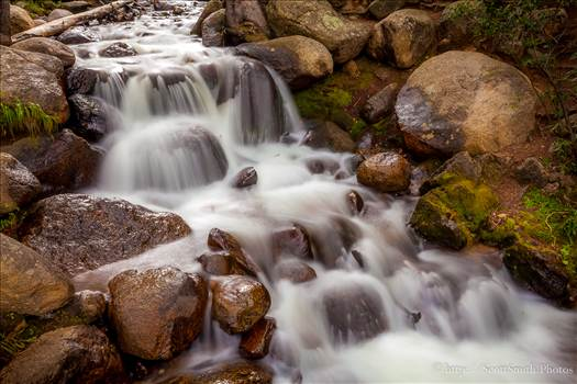 Mt Evans Waterfall - A small stream trickles down the side of the mountain.