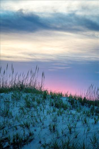 The sun sets over the dunes in the outer banks, Corolla, North Carolina.
