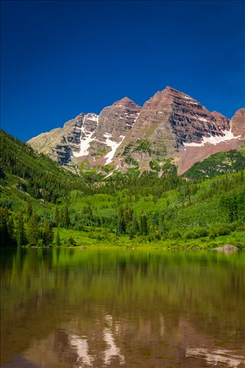 Maroon Bells in Summer No 07 - The remaining snow reflected in the water, at the Maroon Bells near Aspen, Colorado.